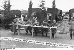 Fritz Witt, Heinrich Himmler and Jochen Peiper with officers of the Waffen-SS Division Leibstandarte Adolf Hitler, Greece, 1941.
