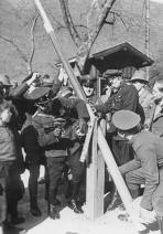 German and Austrian border police dismantle a border post in 1938.
