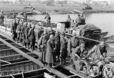 German troops with French prisoners crossing the Meuse on 15 May 1940 near Sedan.