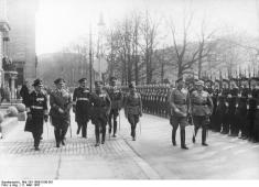 War minister and OKW commander Werner von Blomberg followed by the three armed forces chiefs inspects a parade in honor of his 1937 birthday.
