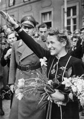 Hanna Reitsch greets well-wishers with the Hitler Salute in her hometown of Hirschberg (Jelenia Góra); April 1941. Karl Hanke, Gauleiter of Lower Silesia, is at left.