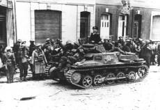 British prisoners of war with a PzKpfw Ib German tank.