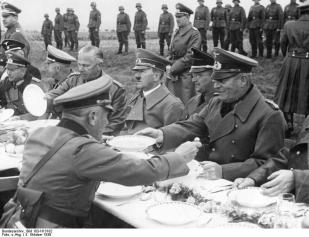 Rest during the German invasion on the road to Franzensbad: Henlein in uniform sitting between Hitler and General Wilhelm Keitel (right), 3 October 1938.