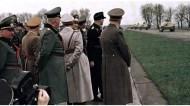 """Arys (Orzysz) in East Prussia, 20 April 1944: Adolf Hitler and his entourage watching the parade of the first twenty Jagdpanzer 38 (Sd.Kfz.138/2) """"Hetzer"""" (Baiter or Troublemaker) on an autobahn as a part of a somber 55th birthday celebration for the Führer. After the demonstration they were sent directly back to the factory since they were not yet completely serviceable. From left to right: Generaloberst Kurt Zeitzler (Chef des Generalstabes des Heeres), Reichsleiter Martin Bormann (Stabsleiter im Amt des Stellvertreters des Führers), Generalfeldmarschall Wilhelm Keitel (Chef des Oberkommando der Wehrmacht), Reichsmarschall Hermann Göring (Oberbefehlshaber der Luftwaffe), Hauptdienstleiter Dipl.-Ing. Karl-Otto Saur (Staatssekretär im Reichsministerium für Rüstung und Kriegsproduktion), unidentified panzer officer, and Adolf Hitler (Führer und oberster Befehlshaber der Wehrmacht)."""