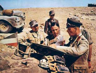 Erwin Rommel (right) with his Chief of Staff Oberst Fritz Bayerlein discussing the map.