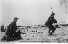A British soldier on Dunkirk's beaches fires at strafing German aircraft.