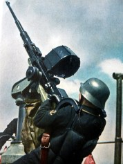 Kriegsmarine Gunner at sea pointing weapon into the sky for protection against air attack.