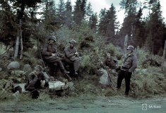 Finnish soldiers taking a break besides a road during the attack phase of the Continuation war in 1941.