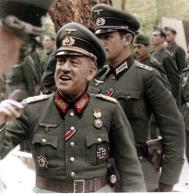 Emilio Esteban-Infantes. The pic taken between April-October 1943. He is wearing Deutsches Kreuz in Gold which he received in 9 April 1943 as Generalmajor and Kommandeur 250. Infanterie-Division (División Azul). There's only two DKiGträger in this division, and the other one is Oberst i.G. Wilhelm Knüppel (15 December 1943). The medal hanging above his left pocket is Medalla Militar Individual de España (Military Individual Medal of Spain). It was awarded for meritorious actions in the presence of the enemy, irrespective of the rank of the recipient. The Hauptmann behind him is Cabo Leon. Please note that Infantes wear holster for Astra 300, his favorite pistole.