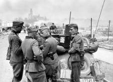 German soldiers confer on the streets of Grodno during Operation Barbarossa.