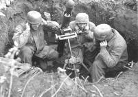 Fallschirmjagers prepare a 8 cm Granatwerfer 34 (81 mm mortar) for the launch.