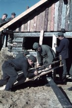 German soldiers building a house in Finland.