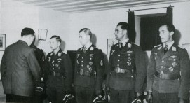 Gordon Gollob (hidden) and Max-Hellmuth Ostermann receive the Oak Leaves with Swords, Helmut Lent, Heinrich Setz and Friedrich Geißhardt receive the Oak Leaves to the Knight's Cross from Adolf Hitler on 28 or 29 June 1942.