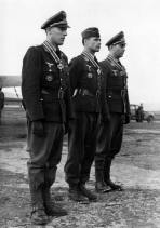 Hauptmann Erich Stoffregen , Hauptmann Konrad Kahl and Hauptmann Willi Flechner of Kampfgeschwader 30 (KG 30) were awarded the Knight's Cross by Generaloberst Hans-Jürgen Stum.