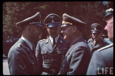 Reichsführer-SS Heinrich Himmler (left) talking with Reichsminister Joachim von Ribbentrop following the French armistice negotiations in Compiègne, northern France, 21 June 1940. In the centre is Himmler's Chief of adjudant SS-Gruppenführer und Generalleutnant der Waffen-SS Karl Wolff.