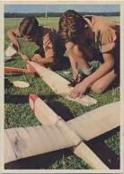 Hitlerjugend making aeroplane models.