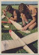 Hitlerjugend making aeroplane models.