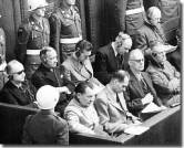Some of the defendants at Nuremberg. Front row, from left to right: Hermann Göring, Rudolf Hess, Joachim von Ribbentrop, Wilhelm Keitel. Back row from left to right: Karl Döwnitz, Erich Raeder, Baldur von Schirach, Fritz Sauckel, Alfred Jodl.