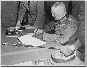 Keitel, signing the ratified surrender terms for the German Army in Berlin, 8/9 May 1945. His Field Marshal's walking stick is on the table.