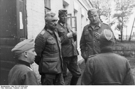 Lieutenant General von Hubicki, Commander of 9th Panzer Division and members of staff being briefed about the possibility that German airmen have been executed in the city of Lemberg (Lvov), which has just been seized by German forces.