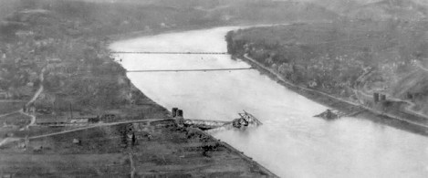 An aerial view of the Ludendorff Bridge after it collapsed on 17 March 1945. Two treadway pontoon bridges are visible to the north.
