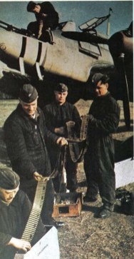 Luftwaffe armourers loading Machine-gun belts into the drums for Messerschmitt Bf 110's formidable nose armament.