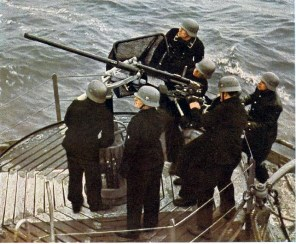 "A color shot of the light naval gun 20mm Oerlikon (2.0cm Flak 28) in action onboard a ""Vorpostenboot"", a converted fishing cutter."