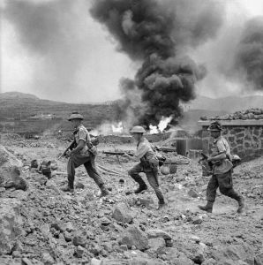 British soldiers advancing inland during Operation Corkscrew.