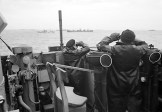 Officers on the bridge of an escorting British destroyer stand watch for enemy submarines, October 1941.