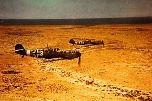Messerschmitt Bf 109's of JG. 27 over Afrika.