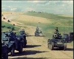 Panzer 38(t) passing the convoy.