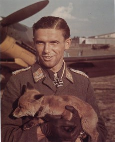 Hauptmann Hans Philipp holding baby wolf.