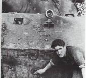 Private Walter Young shows on a hit on his Kpfw. VI Tiger II. The Picture was taken on 26 August 1944.