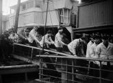 Survivors from Scharnhorst disembarking in Scapa Flow.