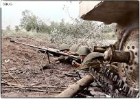 Soviet troops manning a PTRD-41 Degtyaryov Anti-Tank Rifle under cover of a knocked out German Panzer V 'Panther' tank during the Battle of Kursk in the summer of 1943.