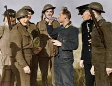 Surrounded by his captors, a Luftwaffe bomber crewman is given a drink of water from a British soldier's water bottle, after baling out of his aircraft, August 30,1940.