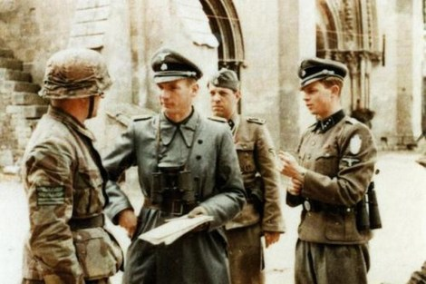"The Command Post of SS-Panzergrenadier-Regiment 25 (12. SS-Panzer-Division ""Hitlerjugend"") at the Ardenne Abbey/Normandy, late June 1944. On the left regimental commander SS-Obersturmbannführer Heinz Milius, in the center (with binoculars) Hubert Meyer, the HJ-Division's first staff officer. The soldier behind Meyer is Herbert Reinecker (1914-2007) who became a famous crime writer for TV series in Germany after the war. He never made a secret about his Waffen-SS membership though."