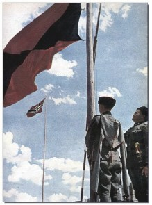 The Cossack flag flies alongside that of Nazi Germany.