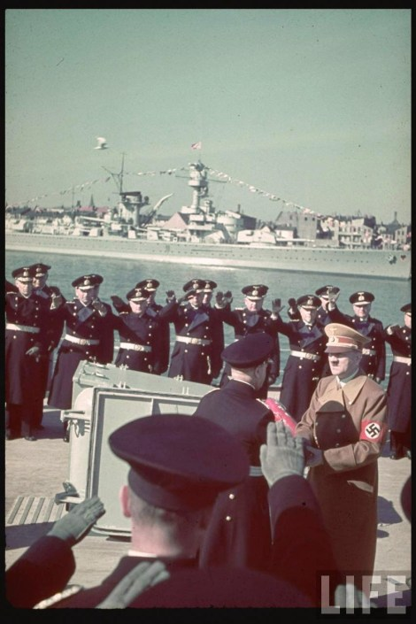 This picture was taken by Hugo Jaeger above Battleship Tirpitz anchored in Wilhelshaven in 1 April 1939, and the occasion was Adolf Hitler's presentation of the Großadmiral (Grand Admiral) baton to Erich Raeder, Oberbefehlshaber der Kriegsmarine.