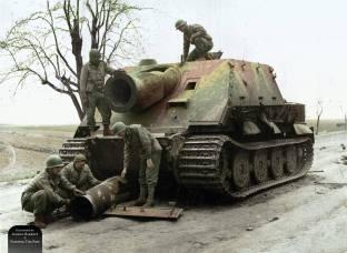 US troops inspect an abandoned Sturmtiger of Sturm-Mörser-Kompanie 1002 near Calbe, Germany, April 1945.