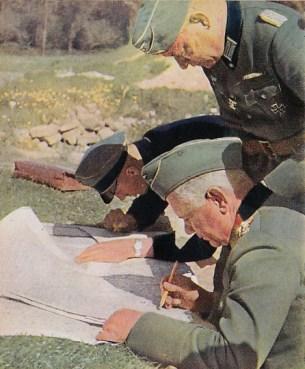 Walther von Reichenau studies a map.