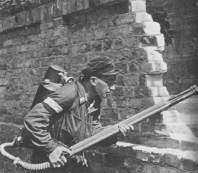 An insurgent armed with a flamethrower.