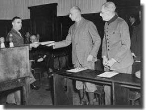 Wilhelm List is handed the indictment in the Hostage Trial in 1947.