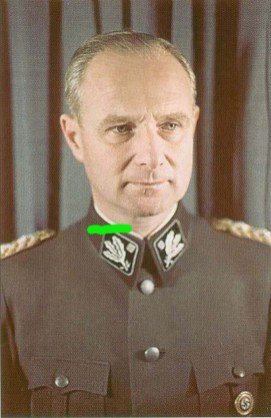 Karl Wolff as an SS-Obergruppenführer und General der Waffen-SS with first pattern of SS collar tab. Visible also his Goldenes Parteiabzeichen der NSDAP.