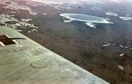German aircraft over Africa. The white edges around the lake below indicated that they were actually a salt lake. Photo taken by General Erwin Rommel during his Campaign in North Africa, 1941.