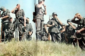 """Wehrmacht combat infantrymen taking a """"Feuerpause"""" (firebreak) - the formal term for """"cease-fire"""", a cigarette break or a short rest break - in their advance in Russia, summer of 1942."""