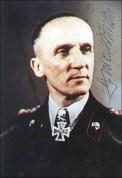 Hasso von Manteuffel in black panzer uniform with signature.