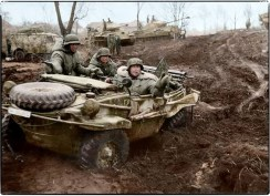Schwimmwagen navigating the mud of Russia with Panthers in the background near Vinnytsia area of the Ukraine in November 1943.