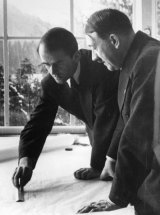 German architect Professor Albert Speer showing German dictator Adolf Hitler (right) some of his plans for Berlin's new outline and buildings.