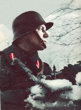 A Soldier of Waffen SS's Latvian Legion wearing a shield without inscription on his lapel.